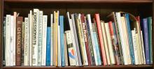 A SHELF CONTAINING A COLLECTION OF ART REFERENCES (53)