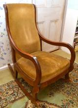 A CEDAR FRAMED ROCKING CHAIR WITH VELVET UPHOLSTERY (MARKS AND STAINS TO UPHOLSTERY)