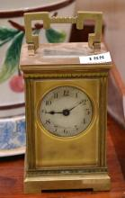 A BRASS CASED CARRIAGE CLOCK, WITH AN ENGINE-TURNED DIAL SIGNED T. GAUNT & CO, MELBOURNE, NO KEY, 15 CM TOTAL HEIGHT