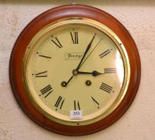 A CONTEMPORARY HARDWOOD FRAMED RAILWAY CLOCK, BATTERY OPERATED
