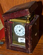 A BRASS CASED CARRIAGE CLOCK WITH AN ENAMELED DIAL, SUBSIDIARY MONTH DIAL AND ONE BELL WITH A KEY AND AN ASSOCIATED TRAVELLING CASE