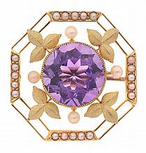 AN EDWARDIAN AMETHYST AND SEED PEARL BROOCH