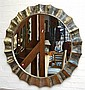 A CIRCULAR WALL MIRROR WITH BEATEN SILVER METAL SURROUND APPROXIMATELY 120 CM DIAMETER