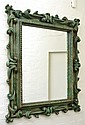 A LARGE RELIEF CARVED AND PAINTED WALL MIRROR, 146 X 122 CM
