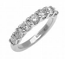 A HALF CIRCLE DIAMOND ETERNITY RING