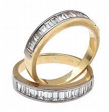 A PAIR OF DIAMOND ETERNITY RINGS