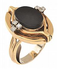 AN ONYX AND DIAMOND COCKTAIL RING