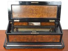 A REVANC BURR WALNUT AND EBONISED CASED MANDOLIN MUSIC BOX