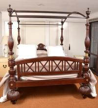 AN ANGLO INDIAN STYLE TEAK FOUR POSTER BED