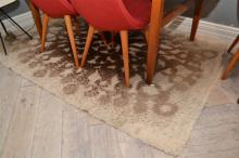A 1960'S RUG IN BROWN AND CREAM TONES (A/F)
