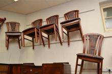 A 1970'S MAHOGANY FINISHED EXTENSION DINING TABLE AND SIX HIGH BACK CHAIRS