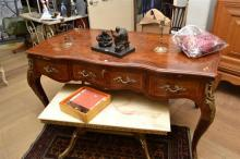 A FRENCH WALNUT ORMOLU MOUNTED DESK (SOME VENEER LOSSES)