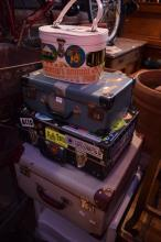 A COLLECTION OF VINTAGE SUITCASES