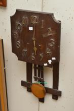 A FINE ARTS AND CRAFTS CLOCK (FAULTS)