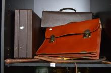 A SHELF OF ITEMS INCL. TWO DOCTORS BAGS, TWO BRIEF CASES AND STOCK WHIP