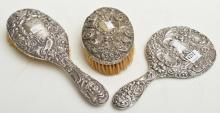 TWO STERLING SILVER BACKED BRUSHES AND A HAND MIRROR, BIRMINGHAM