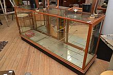 A 19TH CENTURY BOSTON GLASS CO. MELBOURNE DISPLAY CABINET (SHELVES INCL.)