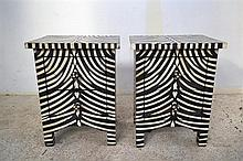 A PAIR OF INLAID BLACK AND WHITE ZEBRA PATTERNED TWO DRAWER BED SIDE CABINETS
