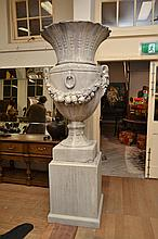 A PAIR OF COMPOSITE VERSAILLES URNS