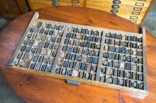AN ORIGINAL EARLY 20th CENTURY 'STEPHENSON BLAKE & CO' DRAWER OF LETTER STAMPS