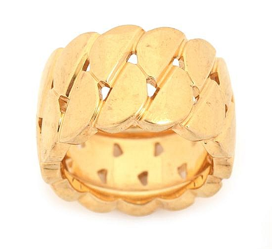 A GOLD RING BY CARTIER