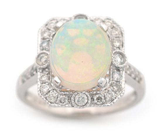 AN ART DECO STYLE OPAL AND DIAMOND CLUSTER RING