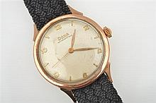 A GENTS DOXA AUTOMATIC WRISTWATCH TO A 14CT GOLD CASE AND BLACK BANDS
