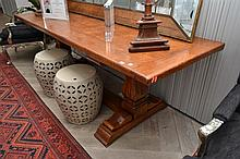 AN OAK REFECTORY TABLE, BUTT ENDED WITH SQUARE BALUSTER PEDESTALS