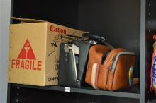 SHELF OF CAMERA AND FILM RELATED ITEMS, INCL. A KODAK EK8 INSTANT CAMERA (WITH UNUSED FILM INSIDE) A CANNON PROJECTOR P-400 AND OTHE...