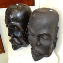 TWO LARGE TRIBAL HEADS (ONE REVARNISHED)
