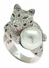 A SOUTH SEA PEARL, DIAMOND AND ONYX LEOPARD RING