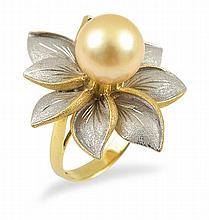 A GOLDEN SOUTH SEA PEARL RING BY LARRY