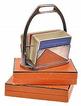 A HERMES SILVER PLATED CARD STAND COMPLETE WITH CARDS AND TWO FURTHER BOXED SETS OF HERMES PLAYING CARDS