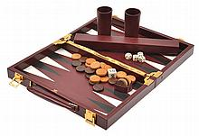 A HERMES LEATHER BOUND TRAVELLING BACKGAMMON SET