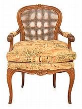 A LOUIS XV STYLE FAUTEUIL, WITH A CANE BACK