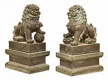 A LARGE PAIR OF COMPOSITE TEMPLE LIONS ON SOCLES