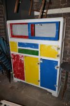 A 1950'S PAINTED KITCHEN DRESSER WITH SLIDING GLASS DOORS