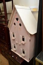 A TIMBER DOLLS HOUSE WITH FURNITURE