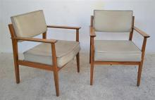 A SET OF FOUR 1960'S BOARDROOM CHAIRS WITH ORIGINAL CREAM VINYL UPHOLSTERY