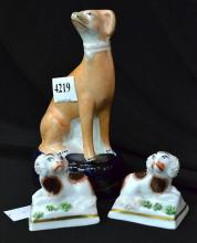 A COLLECTION OF PORCELAIN DOG FIGURES INCL, STAFORDSHIRE.