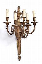 AN ITALIAN NEOCLASSICAL GILT BRASS WALL SCONCE with a fluted body emanating in five sconces, 50cm high
