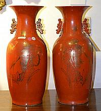 A PAIR OF CHINESE TANGERINE GLAZED PORCELAIN VASES each with shaped handles and gilt crane and calligraphy decoration, 58cm high
