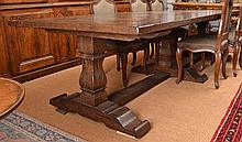 A SUBSTANTIAL FRENCH PROVINCIAL STYLE REFECTORY TABLE with a parquetry panelled top, above baluster supports united by a stretcher, 324.5 x 76 x 125cm