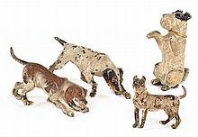 FOUR COLD PAINTED BRONZE DOG FIGURINES  of various dimensions, (losses to all surfaces), the largest 10cm long