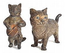 TWO COLD PAINTED BRONZE FIGURES OF CATS  including one with a bobbing head playing a mandolin, (some losses to surface), 8cm high; together with a grey cat stamped 'GESCHUTZT', (some losses to surface), 7.5cm high x 13cm long