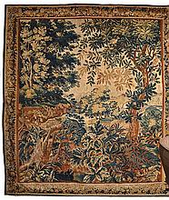 A LATE 17TH CENTURY FLEMISH VERDURE TAPESTRY depicting a landscape scene with a castle in the background, 286 x 250cm