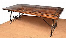 A FRENCH PROVINCIAL STYLE WROUGHT IRON BASED REFECTORY TABLE  rectangular, the top inlaid with ebonised bands and fleur-de-lys above scroll supports and a central stretcher, 239 x 75 x 100cm