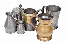 A COLLECTION OF PEWTER AND BRASS TANKARDS AND MEASURES various dates, 17th to 18th century, comprising two graduated measures, three tankards and a lidded tankard, the largest 17.5cm high