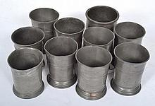 A COLLECTION OF PEWTER BEAKERS various sizes and designs, the largest 11cm high, (10)