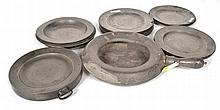A COLLECTION OF PEWTER PLATES, A FOOD WARMER, AND A BED PAN including a set of sixteen plates inscribed 'TROTTER', a further three plates, five dishes, a food warmer and a bed pan various designs, the largest plate 25cm diameter, (26)